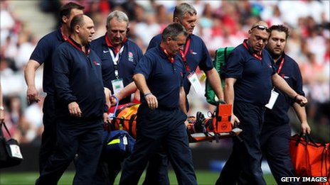 Morgan Stoddart is stretchered off at Twickenham