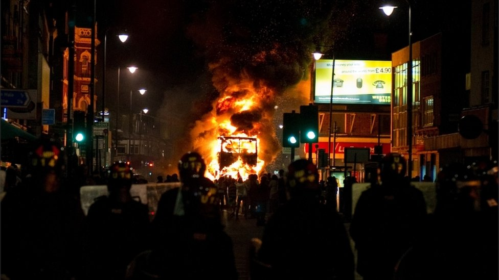A bus on fire and police in Tottenham
