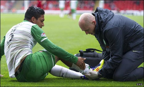 Emilio Izaguirre lies injured