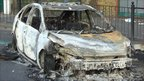 Photo of a burnt out car. Photo: Malcolm Tyndall