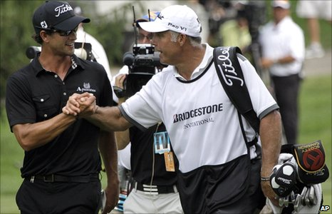 Adam Scott with caddie Steve Williams (right)