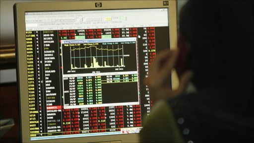 Woman monitors stock market prices in Kuala Lumpur