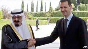 King Abdullah of Saudi Arabia shakes hands with Bashar al-Assad in Damascus (July 2010)