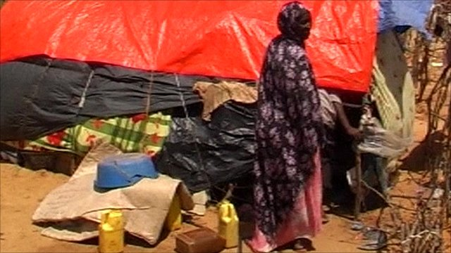 Woman at looted camp in Mogadishu