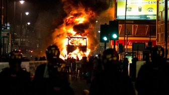 Bus burns during riots in Tottenham, north London