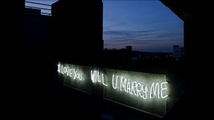 Neon lights of the graffiti &#039;I Love You Will You Marry Me&#039;
