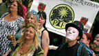 People march into Nottingham's Arboretum as they take part in the Pagan Pride parade on 7 August 2011