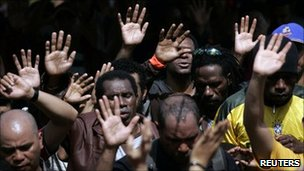 Workers from Freeport-McMoran Copper gather to pray during a week long strike in Kuala Kencana, July 11, 2011