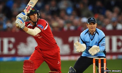 Lancashire's Paul Horton hits out, watched by Sussex keeper Ben Brown