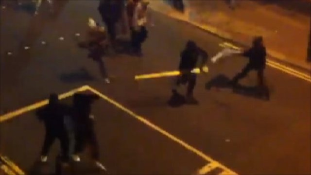 Youths charge police