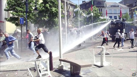 Water cannon being used to disperse football fans in Charleroi in 2000