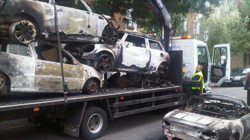 Cars on a truck in Hackney. Photo: Mark Sandell