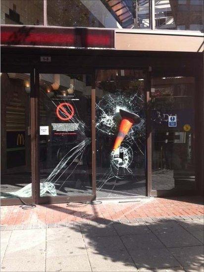 Cone thrown at shop window, Ealing. Photo: Maxine Cotton.