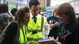 Croydon Council staff sign up people at East Croydon station to help the clean-up 