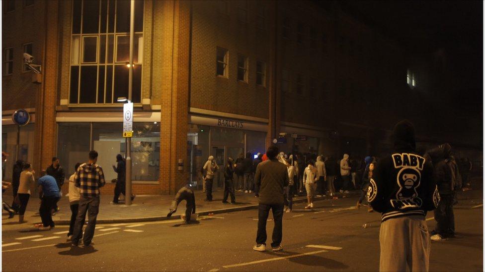 Crowds outside Barclays Bank on Woolwich. Photo: Ho Ke