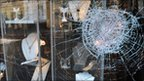 Smashed window of jewellery store in Ealing