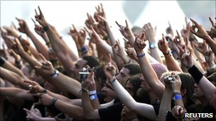 The crowd raises their arms during a performance at an annual heavy metal music open-air festival in the northern German village of Wacken (generic image from 4 August 2011)