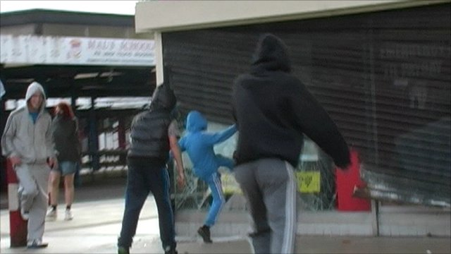 Rioters attack a Salford pawn shop