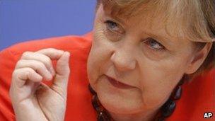 Angela Merkel addresses a press conference in Berlin