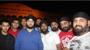 In Southall, west London, hundreds of Sikh men stood guard outside their temple and patrolled the streets on Tuesday night