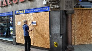 Jim Steel, from Jacobs in Leicester, helping to clean-up the damage to the shop