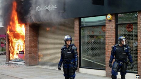 Riot police outside Miss Selfridge in Manchester