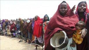 Somali refugees waiting to receive humanitarian aid in Kenya's Dadaab refugee camp