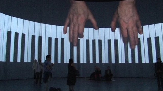 The curtain allows audience to be engulfed by images