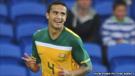 Tim Cahill celebrates scoring Australia's opening goal against Wales