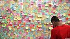 "Hundreds of notes have been posted on a ""peace wall"" on the boarded-up window of a store in Peckham, south London"
