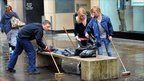 Young volunteers help the clean-up effort in Manchester