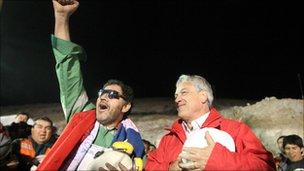 Miners Luis Urzua (left) is greeted by President Sebastian Pinera