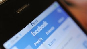 An iPhone displaying facebook