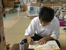 Hyoto lives, sleeps and does his homework in the school gym