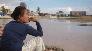 Residents look out at Boeung Kak lake