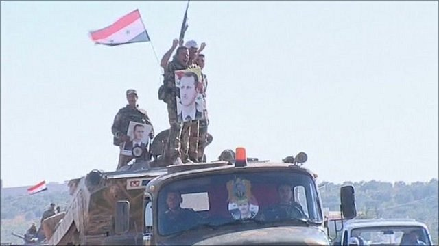 Activists say that Syrian troops are back in the city of Hama