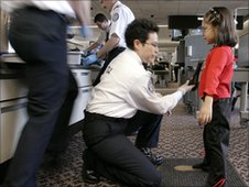 A pat-down check on a young girl at Phoenix Sky Harbor International Airport