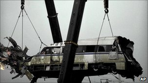 Train lifted from wreckage