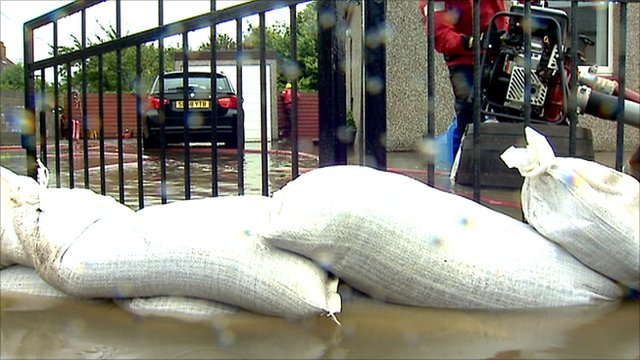 sandbags at flooded property