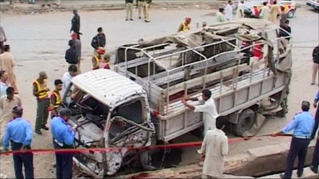 A truck carrying policemen was targeted in Pakistans remote bomb attack