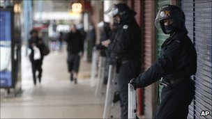 Riot police guard shops