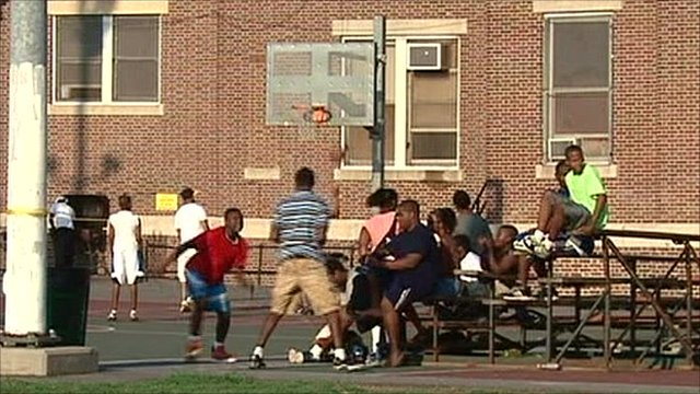 Teenagers in Philadelphia playing basketball