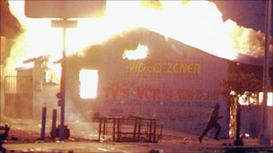 A building burning in the Los Angeles riots of 1992