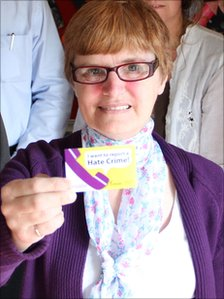 Janine Wheatley, of co-chair of Warwickshire's Learning Disability Partnership Board, holding a card