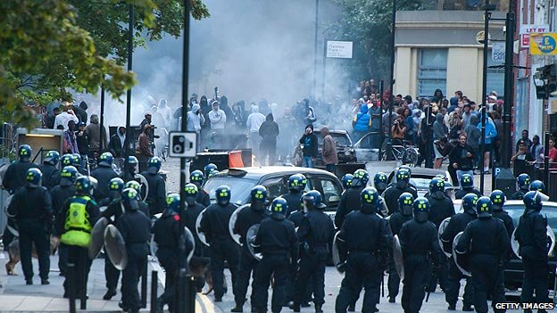 Confrontation between police and rioters in Hackney