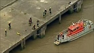 Rescue teams and a rescue boat at the scene 
