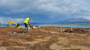 Archaeologist at the site on Skye