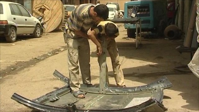 Child working along an adult
