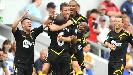 Gary Cahill (centre) is congratulated  by team-mates for his opening goal