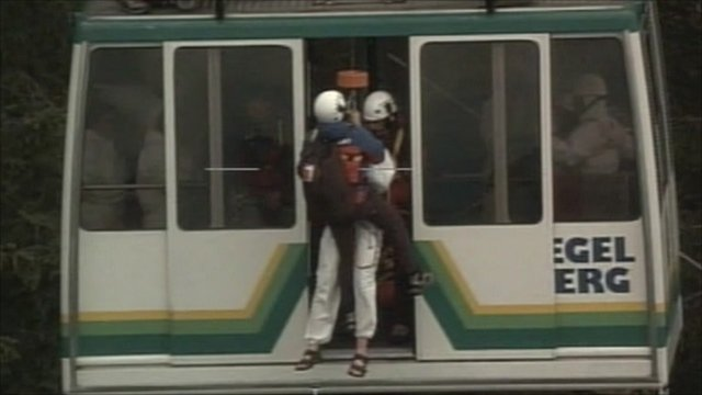 An emergency worker enters the cable car